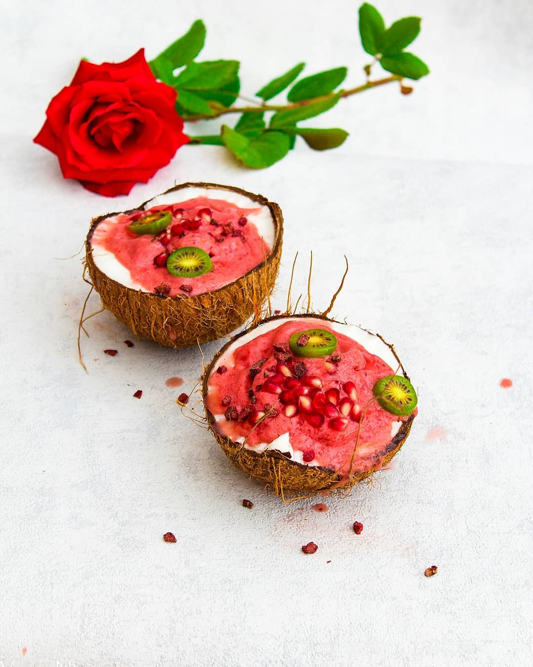Love And Pride In Vegan Health Blogging | Vegan Niinja - Lysa Magazine Smothie in a coconut with a rose flower